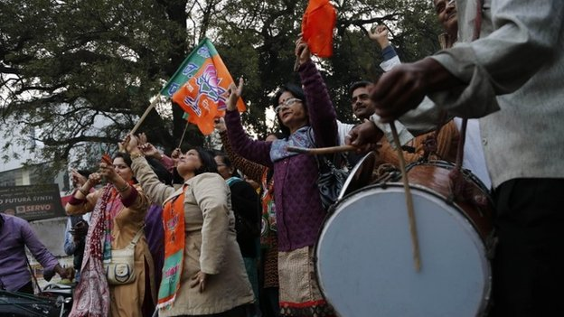 India's main opposition Bharatiya Janata Party (BJP) supporters celebrate the party's victory in various state Assembly elections in Allahabad, India, Sunday, Dec. 8, 2013
