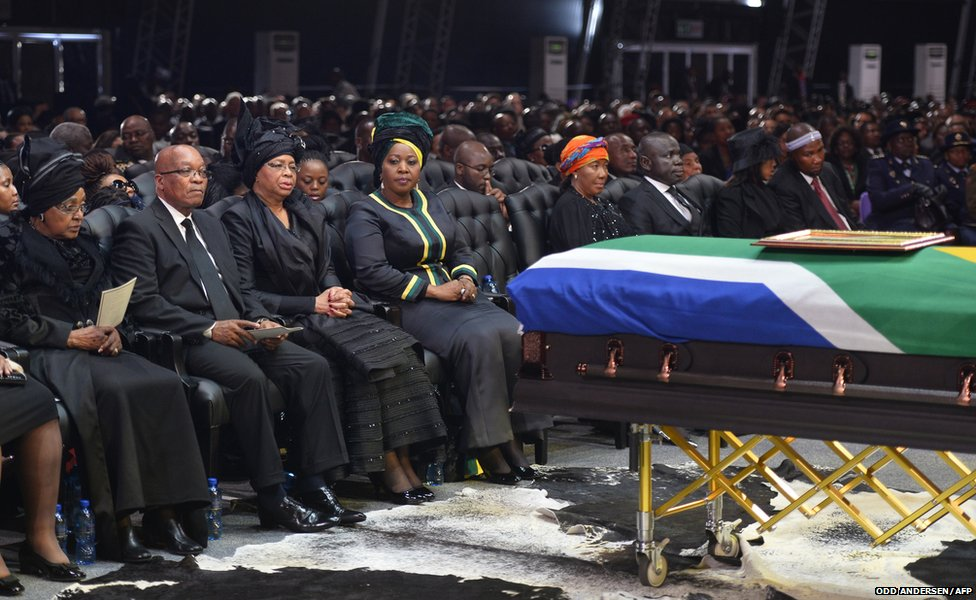 South African President Jacob Zuma sits between Winnie Madikizela-Mandela (left) and Graca Machel