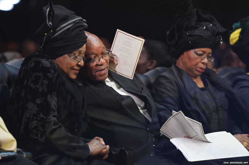 Winnie Madikizela-Mandela, Nelson Mandela's former wife, hugs South African President Jacob Zuma