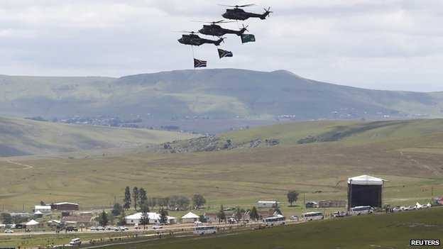 South African military helicopters staged a fly-past as Mr Mandela's coffin was interred