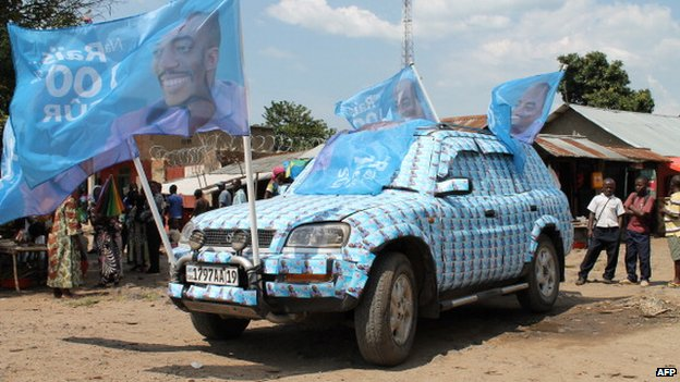 A car is decorated with pictures of DR Congo President Joseph Kabila before his arrival for a visit to Kiwanja in North Kivu on 30 November 2013