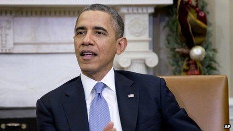 President Barack Obama speaks to the media on 18 December 2013