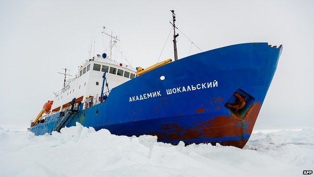 This handout image released by the Centre of Excellence for Climate System Science at the University of New South Wales and taken by Andrew Peacock of www.footloosefotography.com shows the ship MV Akademik Shokalskiy trapped in the ice at sea off Antarctica (27 December 2013)
