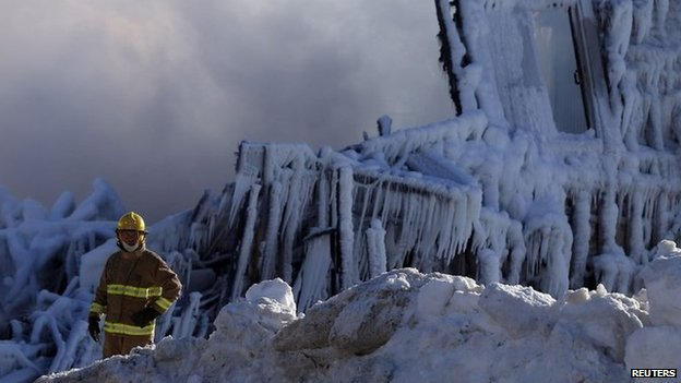 A firefighter looks on at the seniors residence Residence du Havre after a fire in L'Isle Verte, Quebec. 23 Januayr 2013