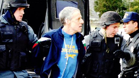 John du Pont being escorted by police