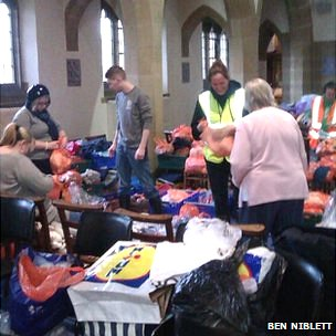 People sorting clothes. Pic: Ben Niblett