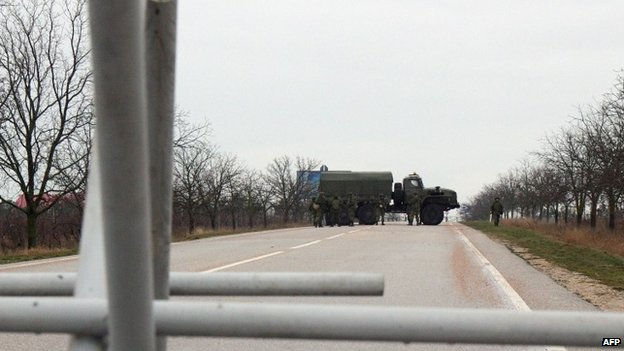 Unidentified men - whom the Ukrainian interior minister says are Russian Naval troops - block a road to a military airport Belbek not far from Sevastopol