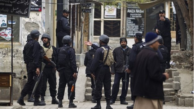 Pakistani police commandos search inside lawyers offices looking for attackers following a suicide attack in a court complex, in Islamabad, Pakistan, Monday, March 3, 2014