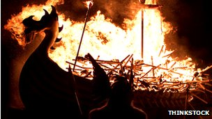 A burning Viking galley ship