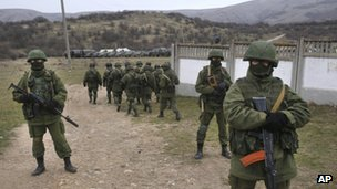 Pro-Russian soldiers guard Ukraine's infantry base in Perevalne on 4 March 2014