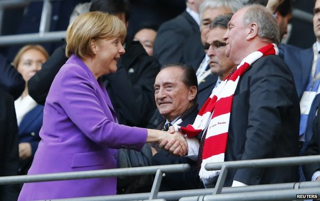 File pic of Chancellor Angela Merkel with Uli Hoeness for the Champions League final in May 2013