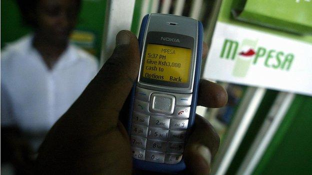 Man uses M-Pesa in Nairobi