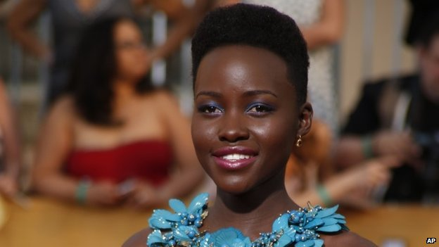 Actress Lupita Nyong'o arrives at the 20th annual Screen Actors Guild Awards in Los Angeles, California, on 18 January 2014