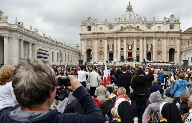 Faithful fill St Peter's Square during a solemn ceremony led by Pope Francis, at the Vatican, April 27