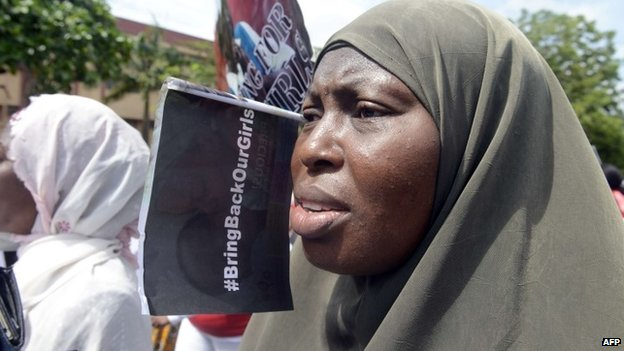 A woman chants slogans alongside members of Lagos based civil society groups holding a rally calling for the release of missing Chibok school girls at the state government house, in Lagos, Nigeria, on 5 May 2014