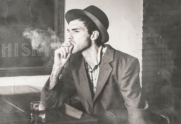 Man at bar smoking