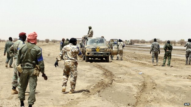 File photo: Malian soldiers patrol on a road between Kidal and Gao in northern Mali, 29 July 2013