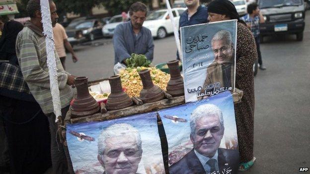 Posters of Hamdeen Sabahi at a stall in Cairo (23 May 2014)