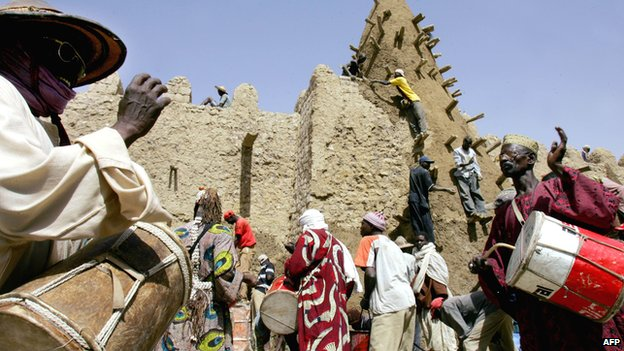 Residents of Timbuktu in Mali encourage workers restoring one of the city's main mosques in April 2006 Mohammed