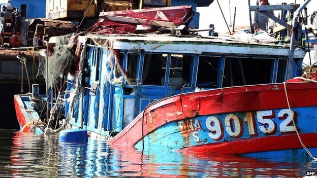 """This picture taken on June 2, 2014 shows the Vietnamese fishing boat """"DNA 90152"""", which was reportedly sunk by a Chinese ship, at a shipyard in the central coastal city of Danang"""