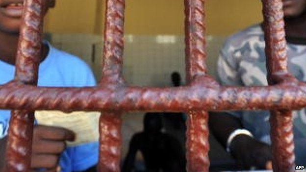 Prisoners in a temporary police cell in Guinea-Bissau  - 2008