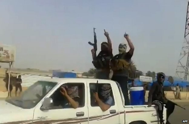 Alleged ISIS militants in the town of Baiji (taken from a video posted on 17 June)