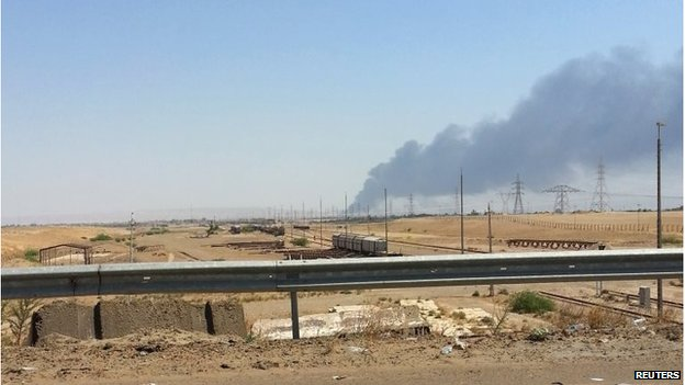 smoke rises from a oil refinery in Baiji, north of Baghdad June 19, 2014.