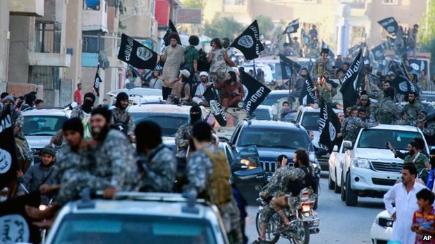 Isis fighters during a parade in Raqqa, Syria in July 2014