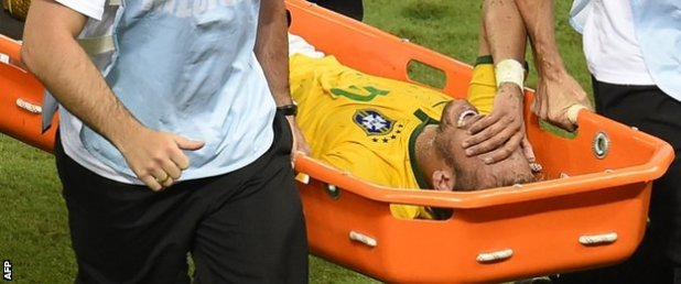 Neymar is carried off on a stretcher