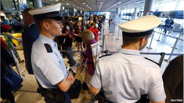 Police officers patrol at a security gate inside the main terminal of Frankfurt Airport July 3