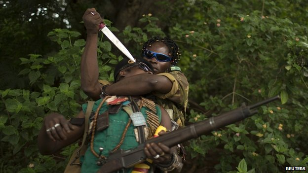 Anti-balaka militiamen simulate an enemy attack as they pose for a photograph near the town of Yaloke - 25 April 2014