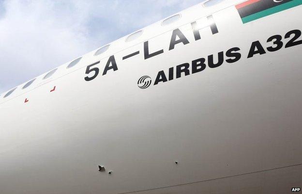 Damaged plane in Tripoli airport
