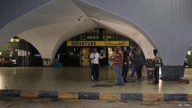 Militiamen in front of the airport