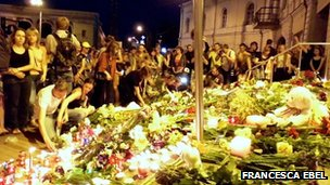 People lay flowers at the Dutch embassy in Kiev