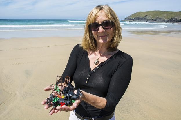 Tracey with Lego haul on beach
