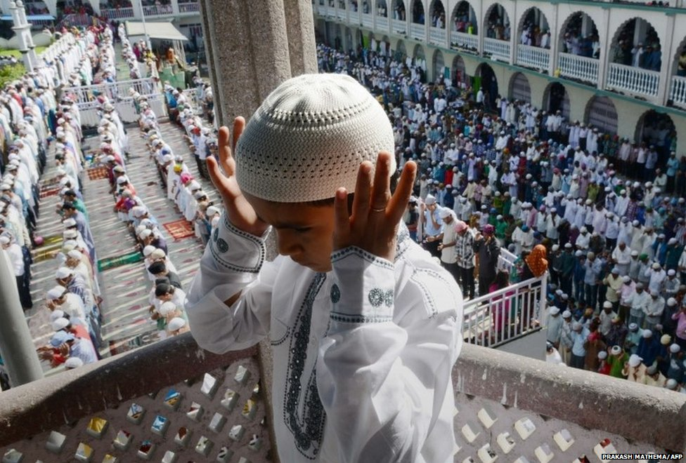 A Nepalese Muslim child offers Eid prayers on the first day of the Edi al-Fitr festival at Kashmiri Mosque in Kathmandu on July 29, 2014