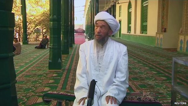 Jume Tahir speaks during an interview at Id Kah Mosque in Kashgar in this still image taken from video dated 3 August 2011