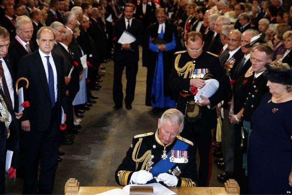 Prince Charles signs a commemoration book in Glasgow