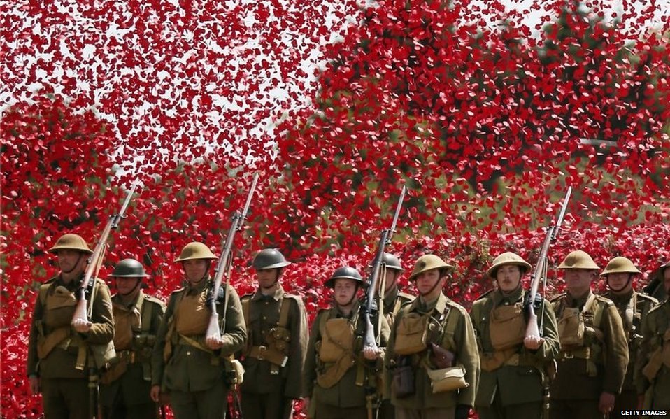 Members of the Great War Society surrounded by poppies