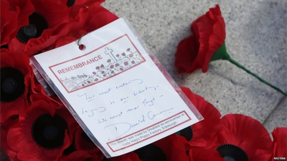 A message on a wreath laid by Prime Minister David Cameron is seen at the Cenotaph in Glasgow