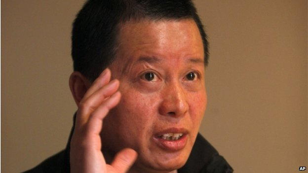 In this 7 April 2010 file photo, Gao Zhisheng, a human rights lawyer, gestures during an interview at a tea house in Beijing, China.
