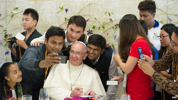 Pope Francis (C) poses for a selfie as he meets young people at the Major Seminar in Daejeon, on 15 August 2014.