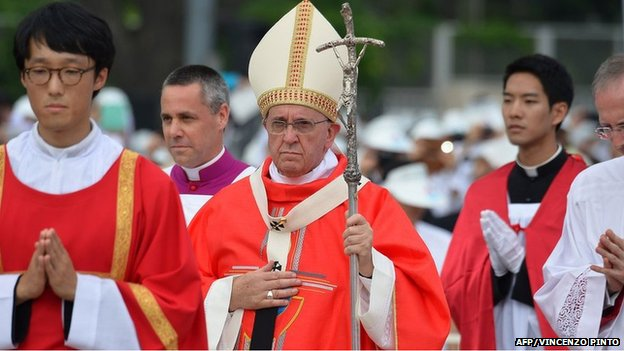 Pope Francis (C) prepares to take part in a beatification mass at Gwanghwamun Square in central Seoul on 16 August 2014.