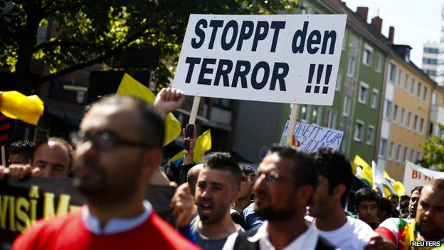 Marchers in Hannover, Germany, condemn violence against Iraqi minorities, 16 August