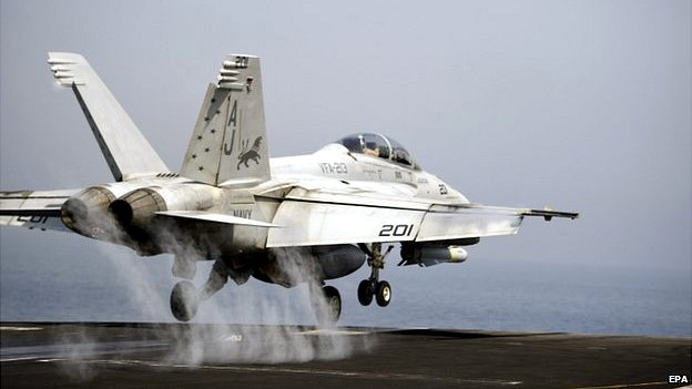 An FA-18 fighter bomber takes off from the flight deck of the US Navy aircraft carrier USS George HW Bush in the Gulf, 15 August