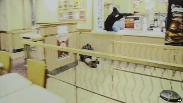Frame grabs from security video showing an armed robbery at a Wendy's restaurant in Omaha is displayed during a news conference at police headquarters in Omaha, Nebraska 27 August 2014