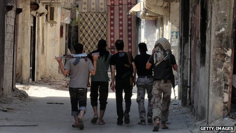 Rebel fighters in Damascus in August