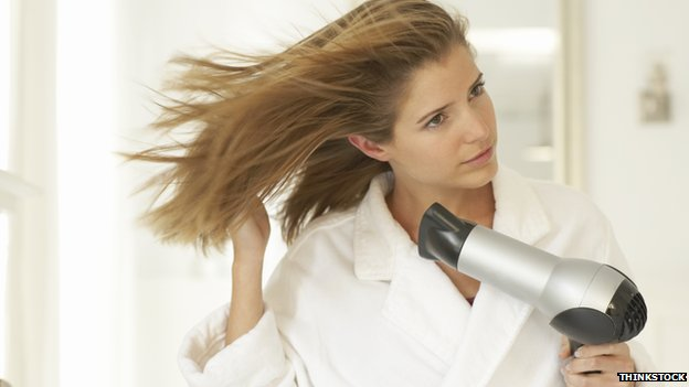 Woman and hairdryer
