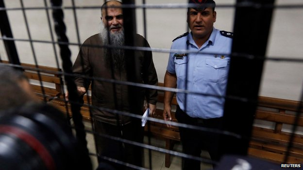 Photographers take pictures of Abu Qatada in court in Amman, Jordan, on 7 September 2014