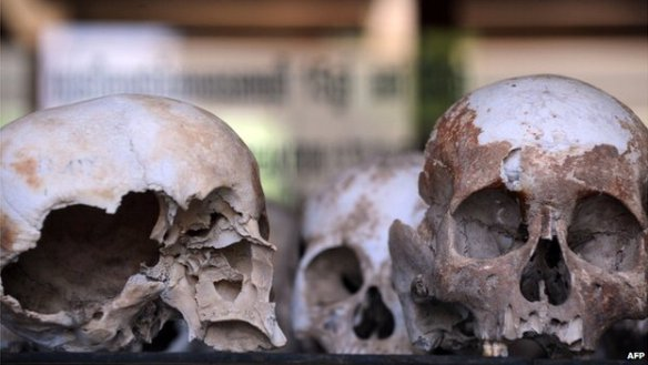 Skulls are displayed at the Choeung Ek killing fields memorial in Phnom Penh on 25 June, 2011